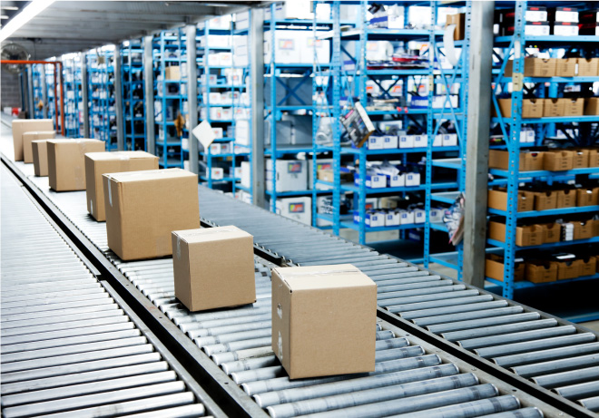 packages on a conveyor belt in a warehouse