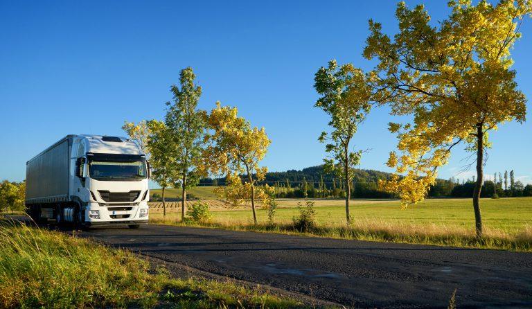 semi truck driving down rural road