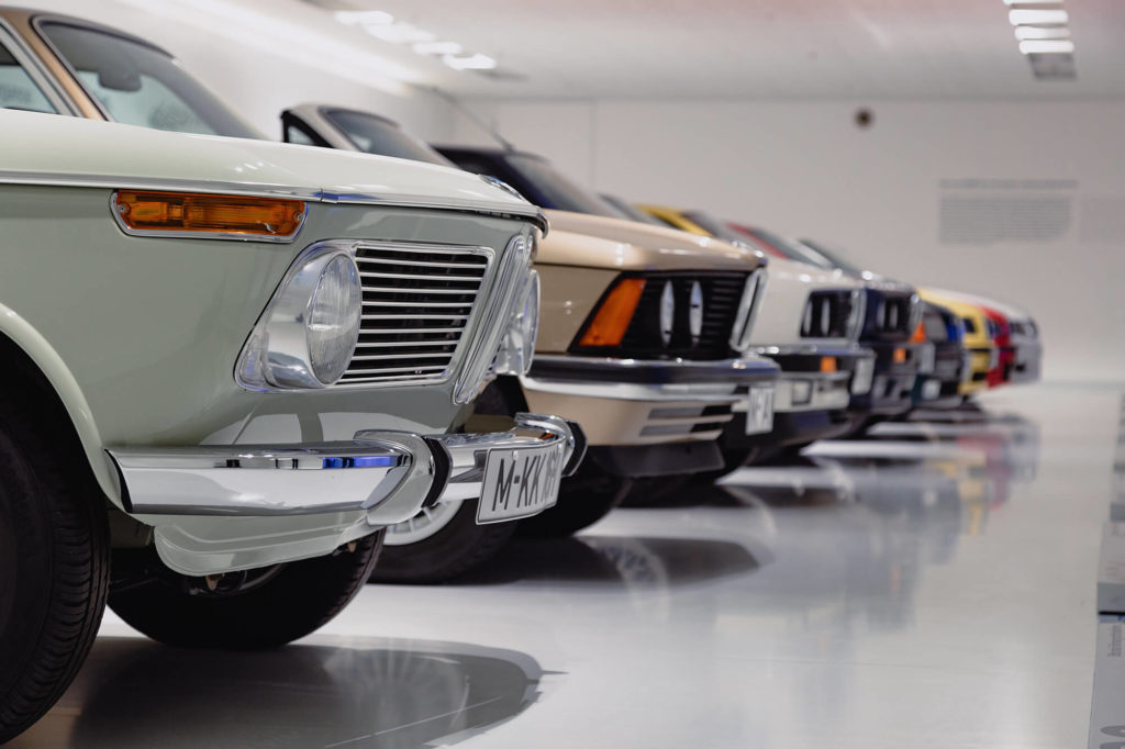 classic cars parked in a climate controlled garage