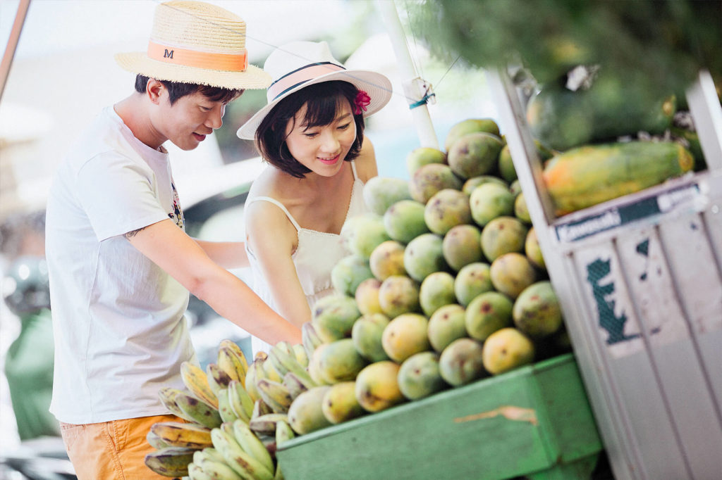 couple shopping for fresh fruits at a market