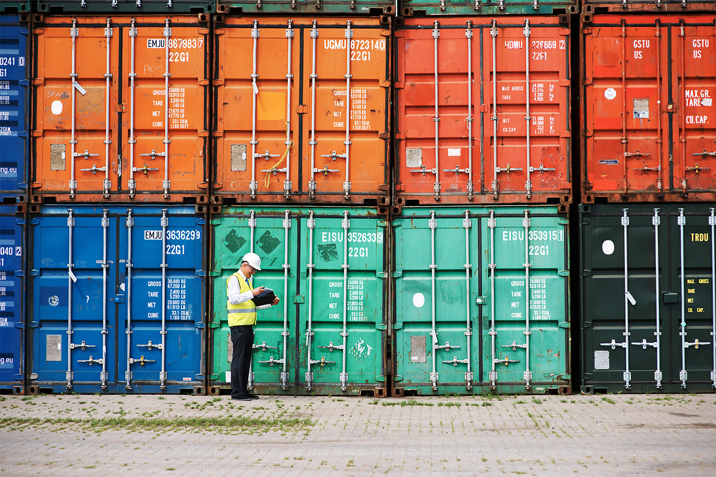 worker checking shipping containers