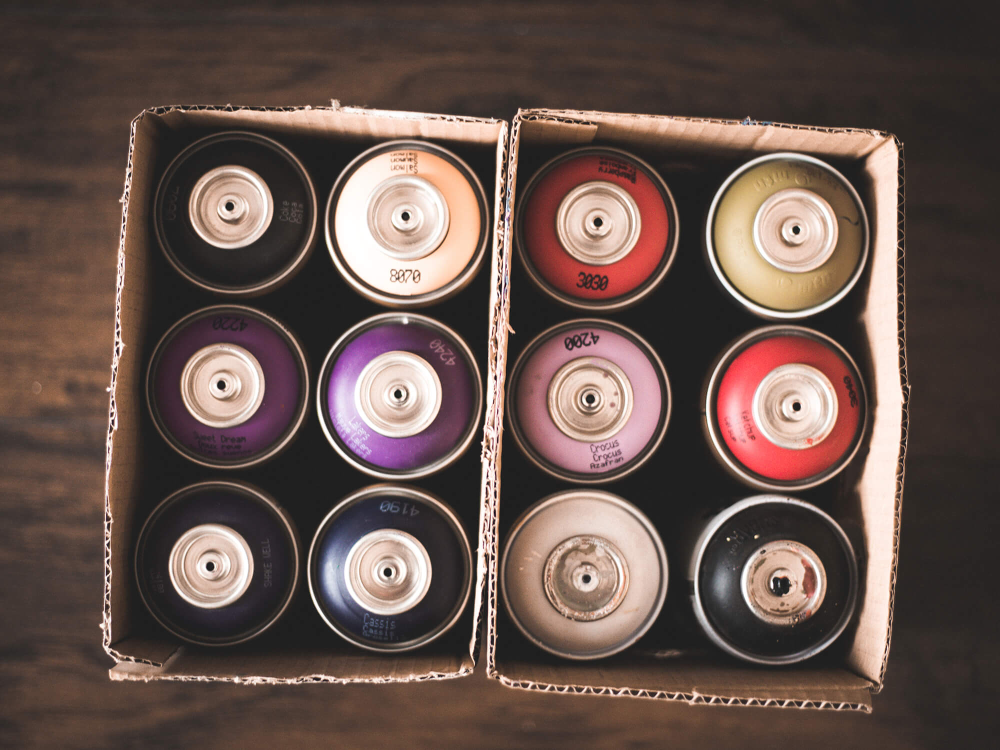 top down shot of montana spraypaint cans