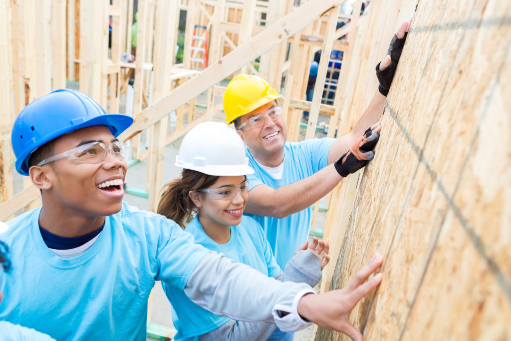 Confident volunteers build wall in charity home