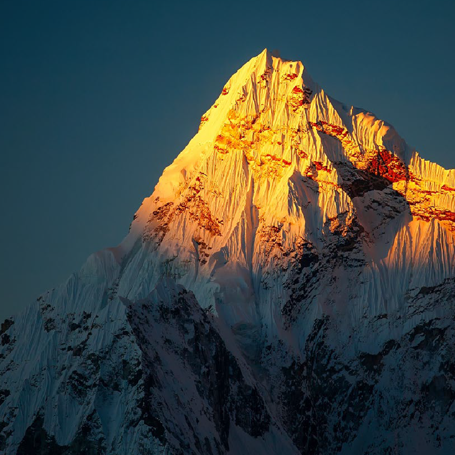 image on a mountain peak in the sun