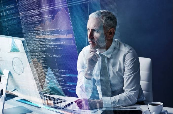 man looking pensively at computer