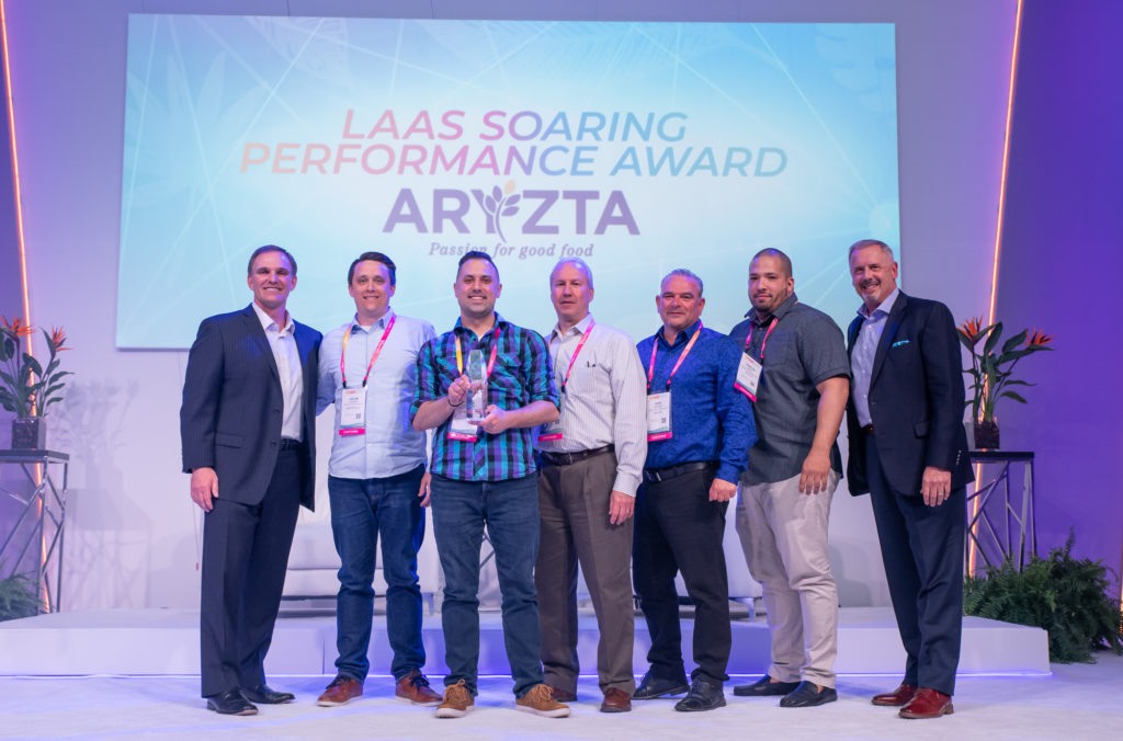 team receiving LaaS soraing performance award 2019 aryzta