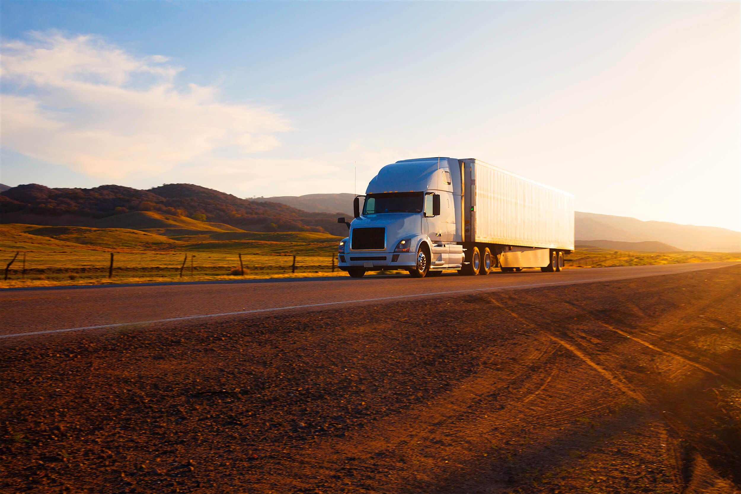 Semi truck drives down the road