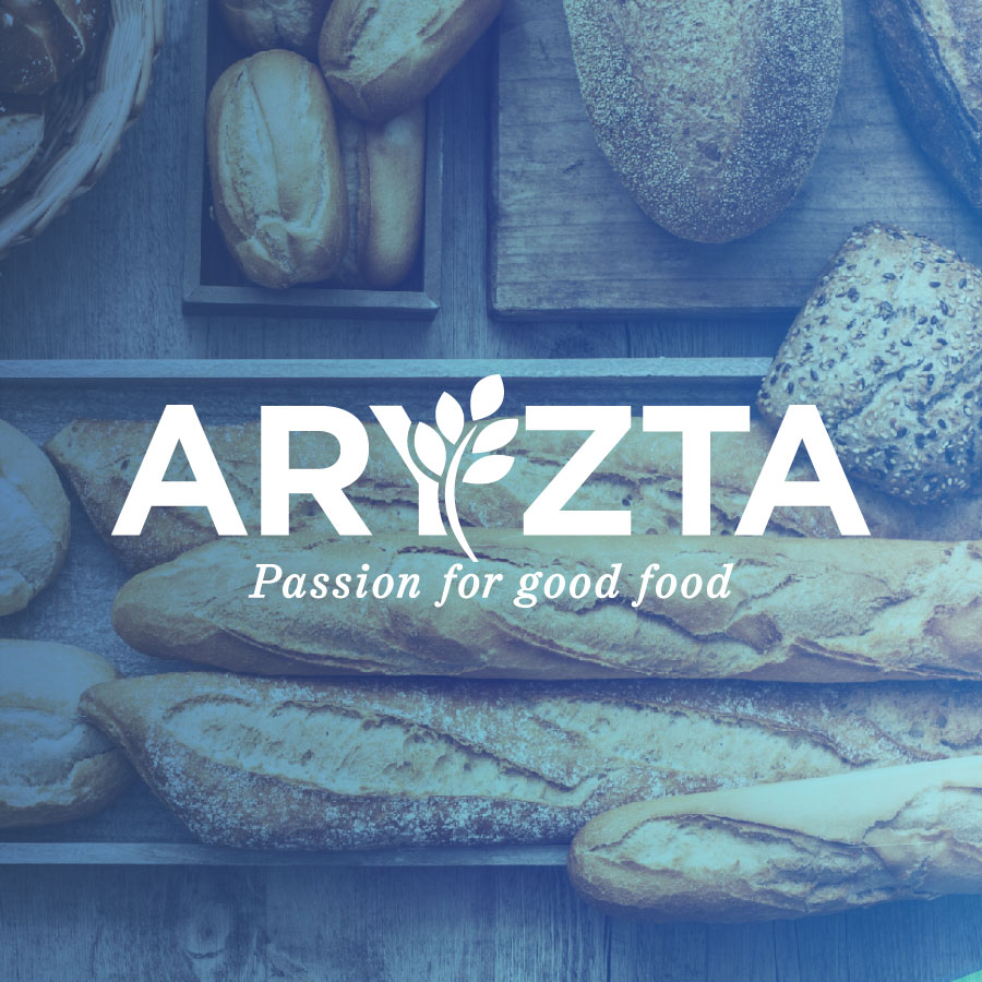 aryzta passion for good food logo over fresh baked breads